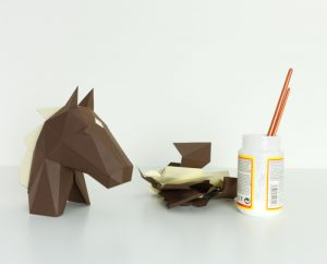 horse papercraft being assembled image