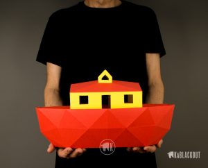 Photograph of person holding papercraft Noah's Ark
