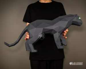 Photograph of a person holding KaBlackout's Papercraft Panther